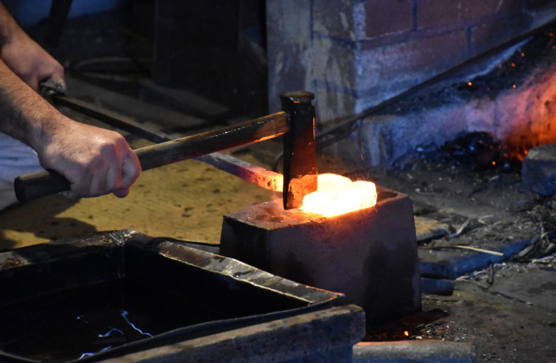 The steel is cut, folded and hammered repeatedly