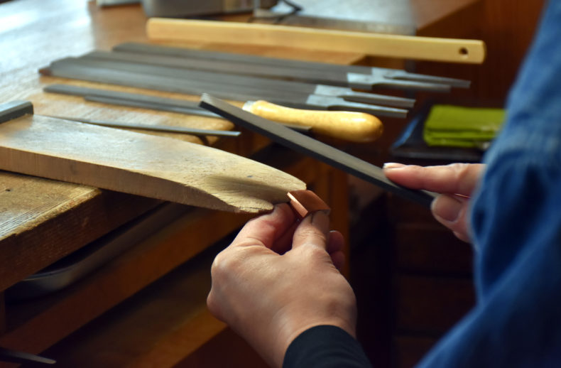 The 'habaki' is being made by a craftsman