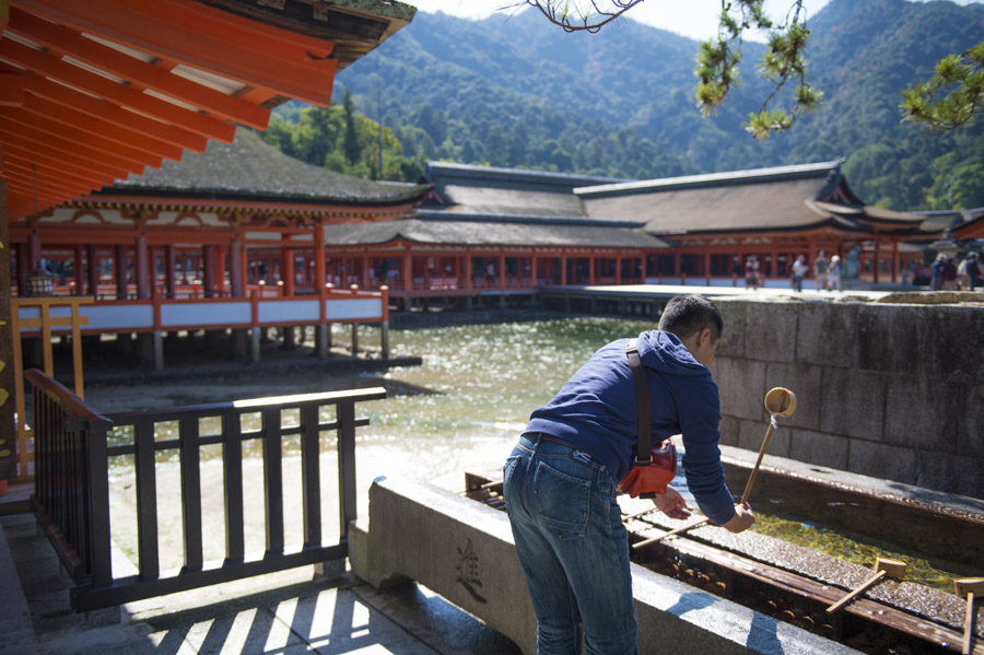 Washing and purifying at the entrance to Itsukushima Shrine