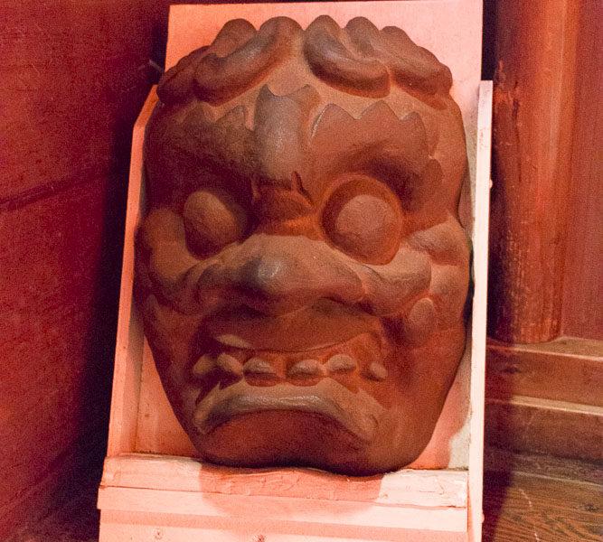 Ura's demonic visage.