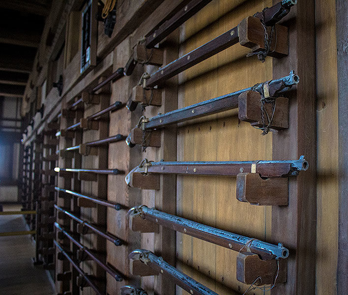Weapon racks found inside the castle display traditional matchlock firearms.