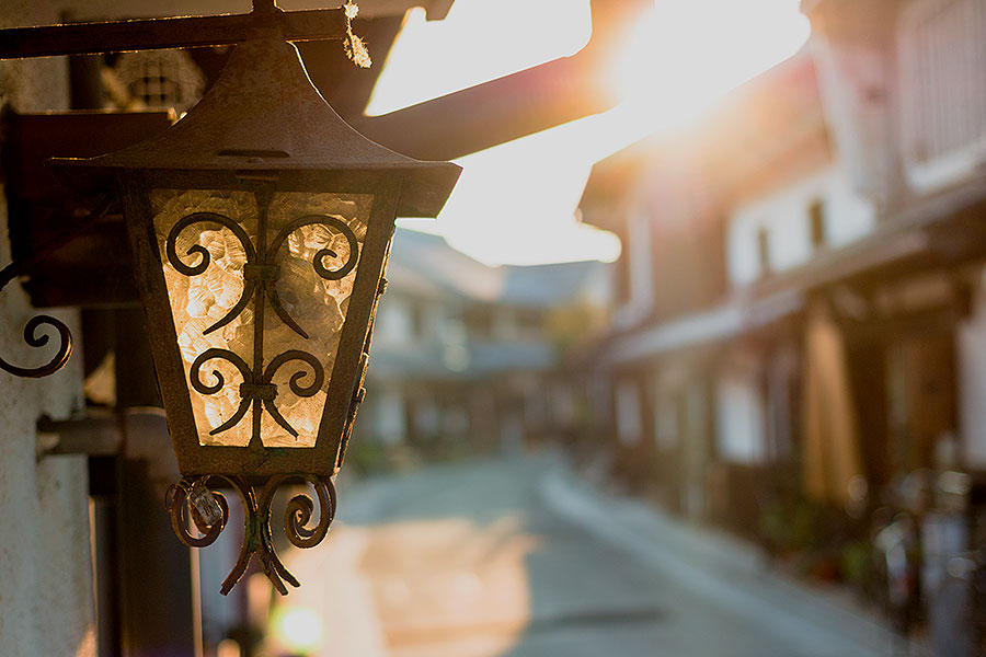A beautiful handmade lantern catches the sun's rays outside a shop in Bikan District.
