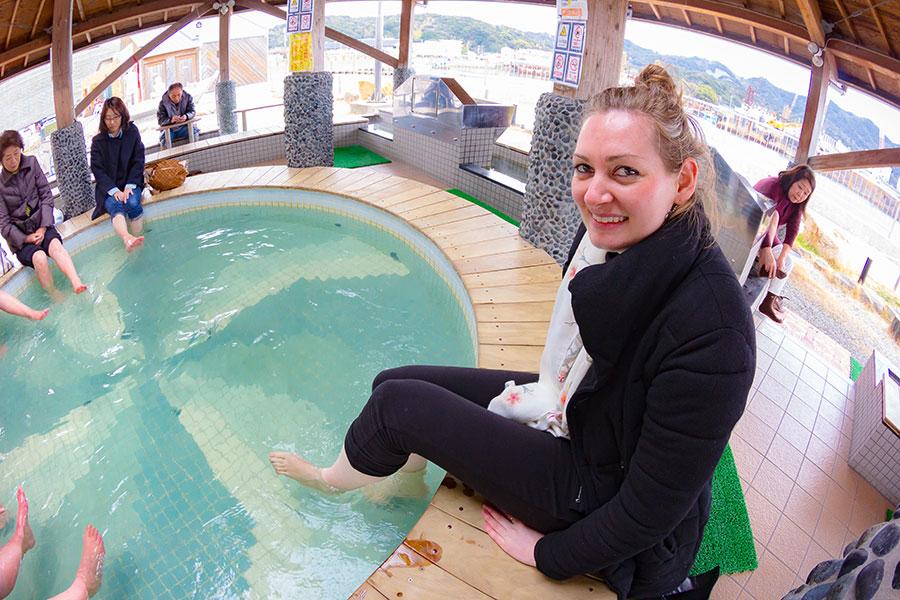 Having a relaxing soak in the ashiyu uzunoyu (hot spring foot bath), located near the boarding area.