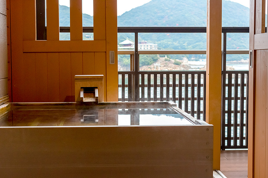 Open-air hot spring baths adorn each room's balcony.