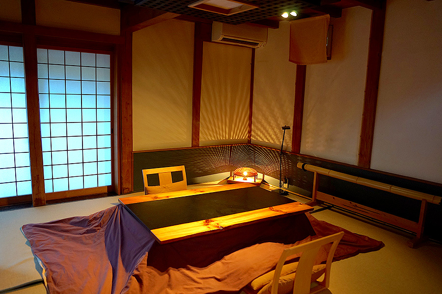 The sunken kotatsu heated table is the highlight of this gorgeous traditional Japanese room.