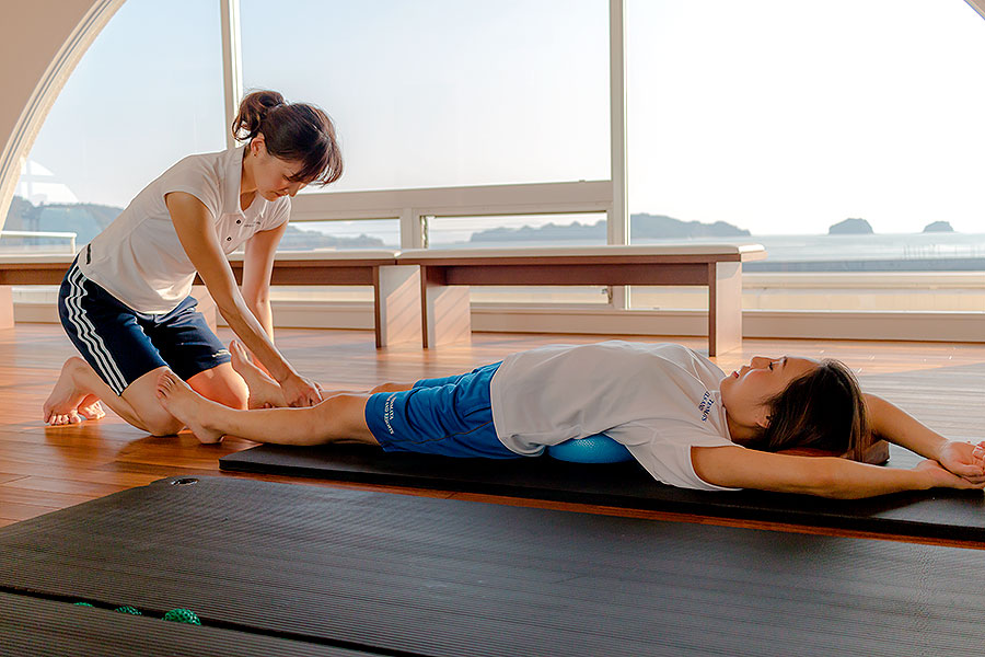 Shoko Yamagichi (left) guides us through some relaxing exercises in Hotel Limani's gym studio.