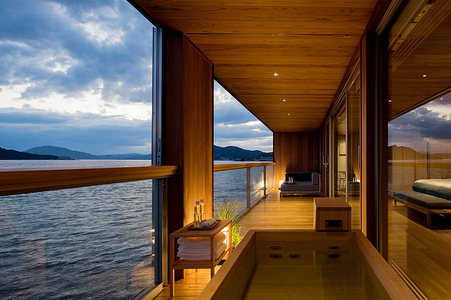 Luxuriating in a balcony bathtub while watching the islands pass by — a bliss-inducing experience.