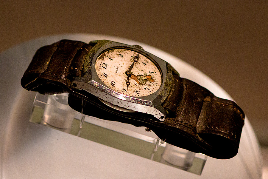 A wrist watch stopped at 8:15 AM — a relic from August 6th, 1945, on display at the Hiroshima Peace Memorial Museum.