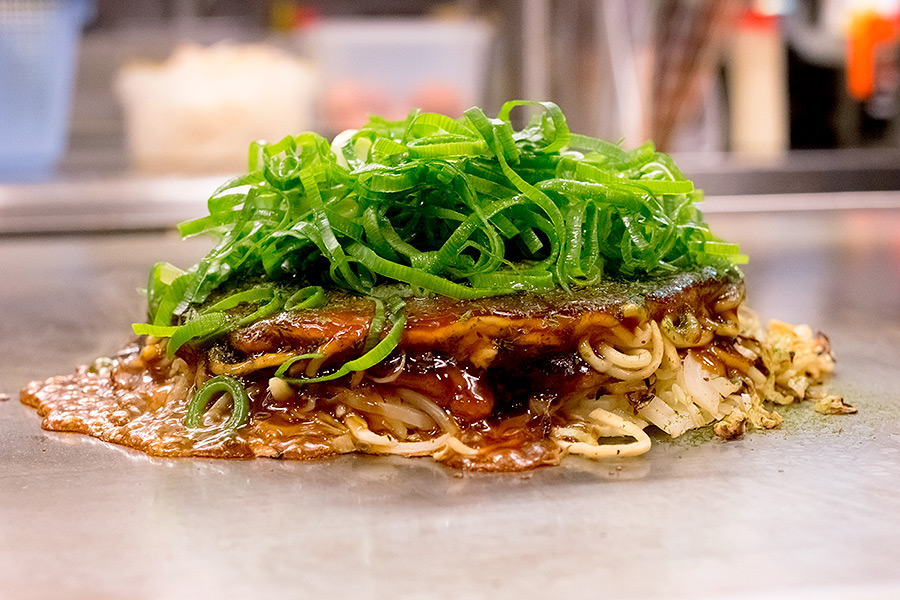 Grilled before your eyes, Koshida provides classic okonomiyaki with your choice of udon or soba noodles and a wide range of toppings.