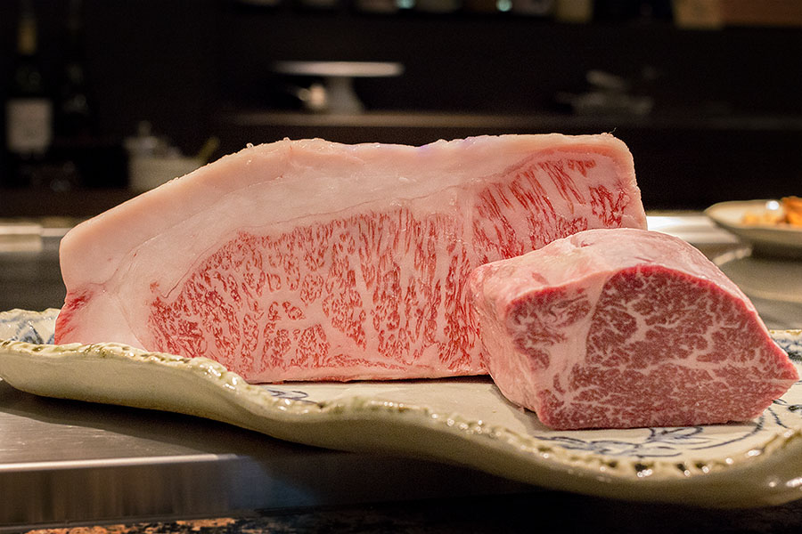 Fresh Kobe Beef, filet (rear) and sirloin (front), ready for the grill.