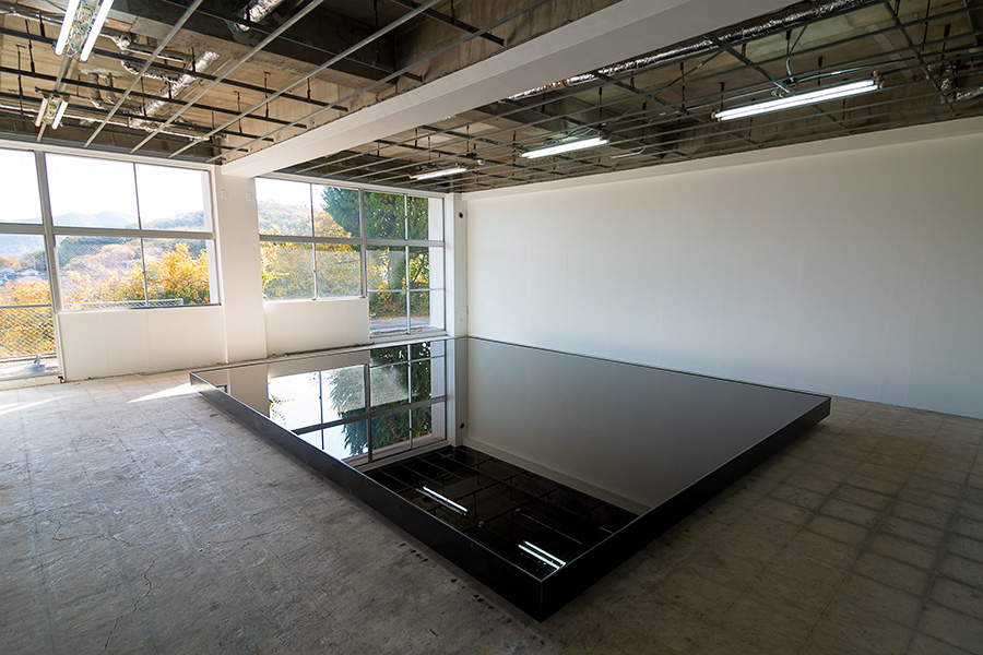 "Much of the work at Art Base plays off the wastefulness of mass consumerism, such as with this pool of waste oil, entitled ""Bussei I,"" by Noriyuki Haraguchi."