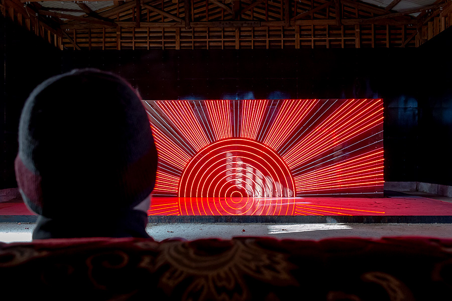 "Installed in an old cinema theater on Momoshima Island, ""Hinomaru Illumination"" by Yukinori Yanagi goes through a light show depicting the flag of Japan."