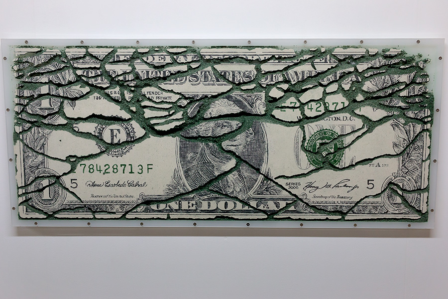 """One Dollar E78428713F,"" a U.S. dollar recreated with sand and laced with ant tunnels, part of a series of such works by Yukinori Yanagi."