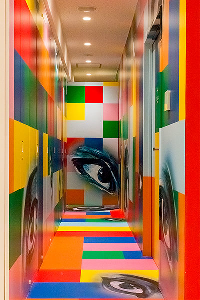 A hallway in the Yokoo Tadanori Museum of Contemporary Art decorated with Tadanori's paintings.
