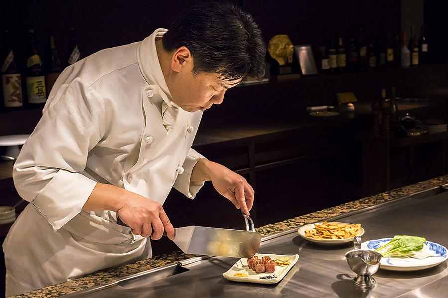 Chef Akira Kajiwara, a true master of his art, delicately arranges each morsel before serving it to his guests.