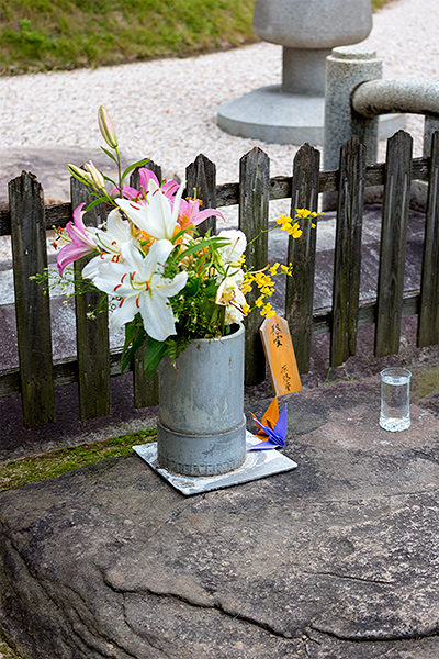 Flowers, origami cranes, and water — offerings to the A-bomb victims commonly found in Hiroshima's Peace Memorial Park.