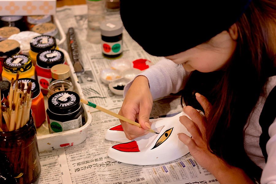 Kagura Monzen Tojimura's community space features a kid's space and workshops in which you can make your own kagura mask.