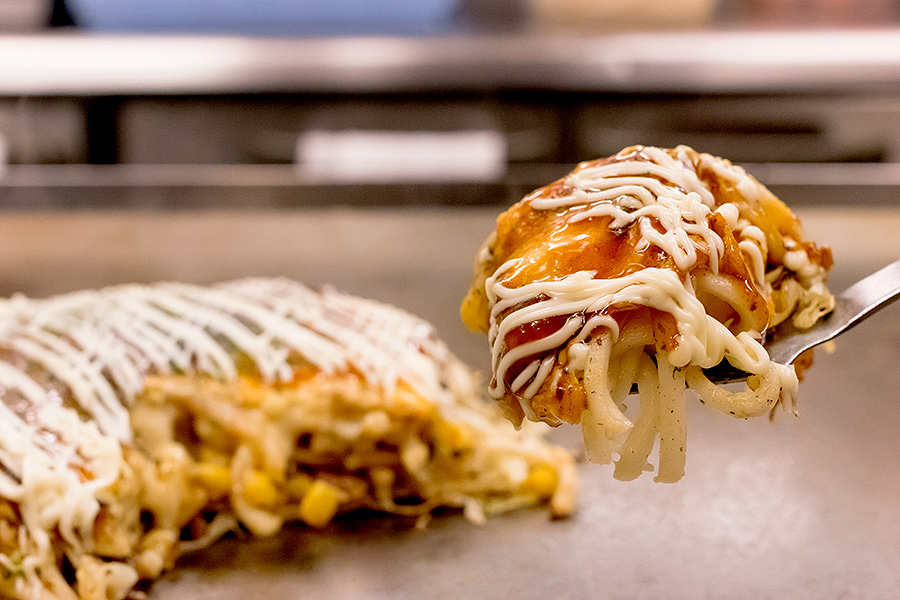At Koshida, you'll eat your okonomiyaki the traditional way —  hot off the grill with a mini spatula.