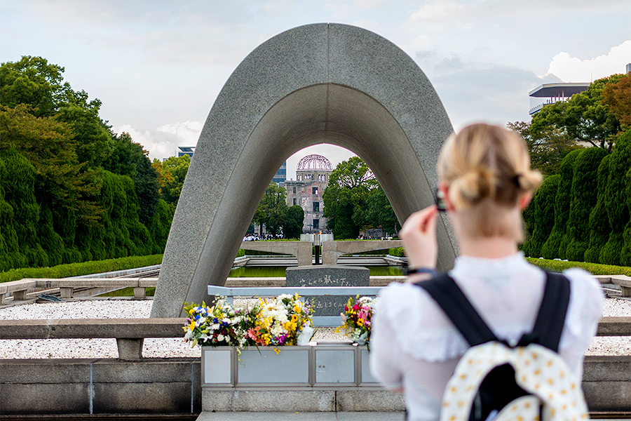 Perfectly framed in the Cenotaph stands the A-bomb Dome and Flame of Peace — a fire that will burn until the abolition of nuclear weapons.